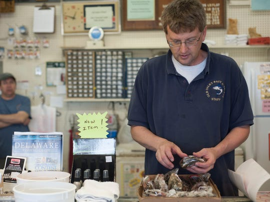 Clark Evans, manager at Old Inlet Bait & Tackle, puts