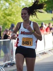 Nicky Nesi crosses the finish line as the women's winner