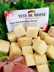 """Tete de Moine is a less common """"Swiss cheese"""" that"""