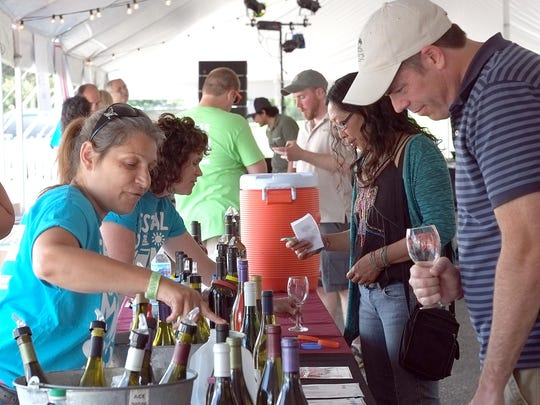 People have lots of wine and beer choices to try out at the Festival of the Sun in Lansing's Old Town Saturday.
