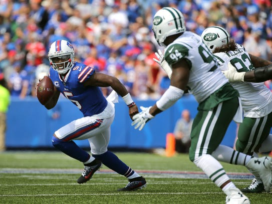 Bills quarterback Tyrod Taylor is chased out of the