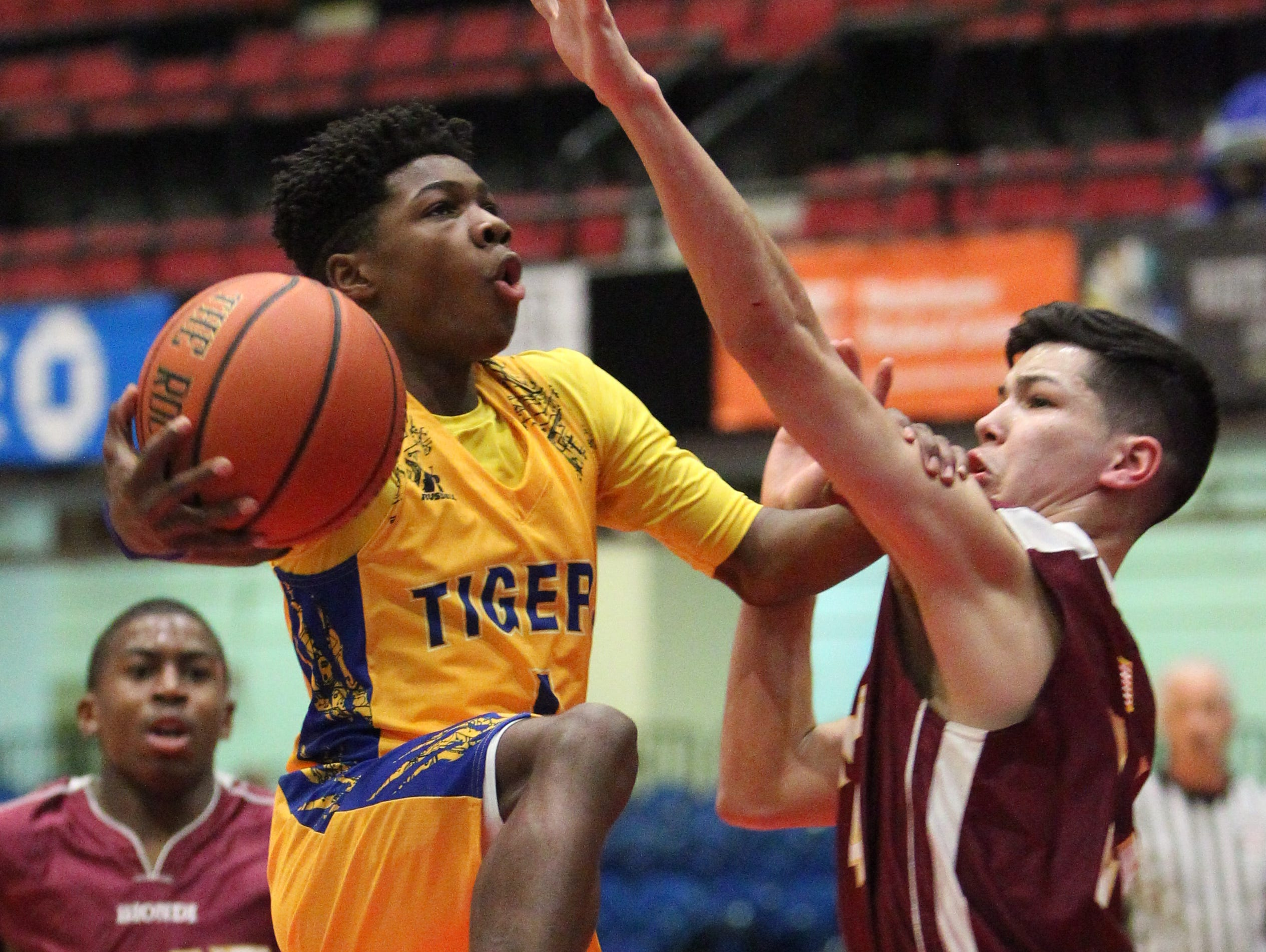 Martin Luther King's Romello Faison drive on Biondi's Jerrell Rivera during their Section 1 Class D semifinal at the Westchester County Center Feb. 19, 2016.