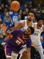 Dec 20, 2017; Durham, NC, USA; Evansville Purple Aces guard Duane Gibson (25) looses the ball in front of Duke Blue Devils guard Gary Trent Jr. (2) during the first half at Cameron Indoor Stadium. Mandatory Credit: Rob Kinnan-USA TODAY Sports