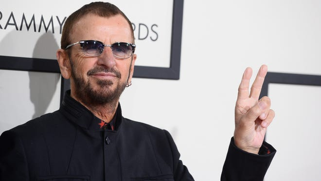 Ringo Starr arrives at the 56th annual Grammy Awards at Staples Center on Sunday, Jan. 26, 2014, in Los Angeles. (Photo by Jordan Strauss/Invision/AP)