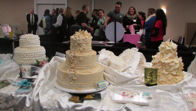 Elegant wedding cakes from Betty Kay Bakery in Bath were on display at Sunday's wedding expo in Corning.