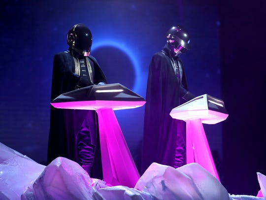 Daft Punk performs at the 59th annual Grammy Awards
