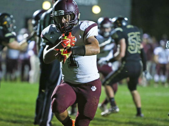 Stuarts Draft's Logan Leche carries the ball to score a touchdown during the first half of Friday's game at Buffalo Gap on Oct. 6, 2017.