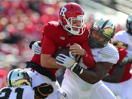 Rutgers quarterback Giovanni Rescigno (17) is sacked by Gelen Robinson (13) and Markus Bailey (21) of Purdue  during the first quarter of a game at Rutgers on October 21, 2017 in Piscataway.
