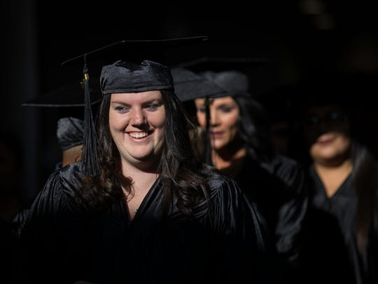 Kimberly Howard walks with fellow graduates, Thursday, June 15, 2017 to their San Juan College HSE commencement ceremony at the Henderson Fine Arts Center Performance Hall in Farmington.