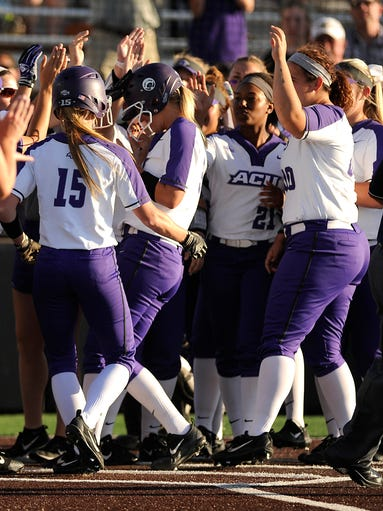 Abilene Christian's Peyton Hedrick (3) is congratulated