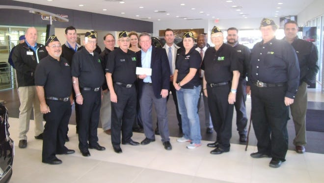 Paul Tigrett, center, of Patterson's Family of Dealership presents a check to the DAV Ch. 41  members on the Veterans Day event held in November which was a huge success to help area veterans.