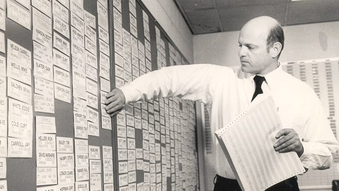 MAY 1, 1984: Pete Brown, Bengals Player Personnel Director, looks over potential draft picks at the club's Riverfront Stadium headquarters. The Enquirer/Allan Kain Scanned 6/12/2017 Cincinnati Bengals