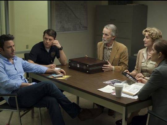 "Ben Affleck, Lisa Banes, David Clennon, Kim Dickens and Patrick Fugit in a scene from ""Gone Girl"" (2014)."