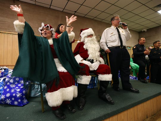 Marilyn and Daniel Schievella of Leonia as Santa and Mrs. Claus with their son Undersheriff for the Morris County Sheriff's Office William Schievella, introducing the Italian American Police Society of New Jersey's annual Big Brothers and Sisters of New Jersey Children's Christmas Party at the Whippany American Legion Hall. December 19, 2015, Whippany, NJ.