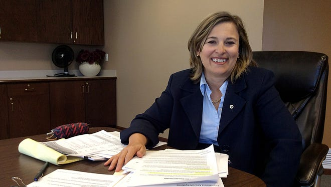 Sarah Jewell sits Friday in the offices of Reichert Wenner in St. Cloud. The lawyer has recently begun presenting on drones in Minnesota.