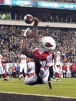 Cardinals receiver John Brown attempts to catch a pass in the end zone against the Eagles in Philadelphia on Sunday, Dec. 20, 2015.