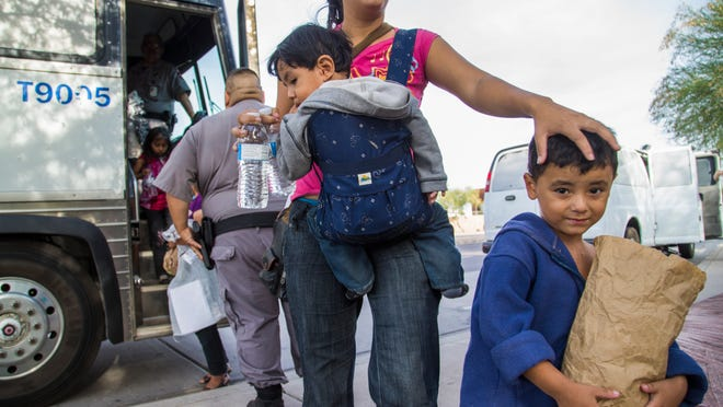 Seydi Maricela Sequeira-Alvarenga, 23, and her children Olvin (left), 1, and Oliver, 3, are released by ICE near a Greyhound bus station in Phoenix June 2, 2014. They illegally crossed into the U.S. near McAllen, Texas, and were paroled by ICE until Sept 3. Undocumented immigrants from Central America have been released at Greyhound bus stations in Tucson and Phoenix over the past several days after they were flown to Arizona from south Texas.