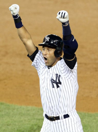 Yankee captain Derek Jeter celebrates his game winning hit against the Orioles during his final game at Yankee Stadium Sept. 25, 2014.