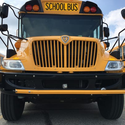 One of Muncie's new school buses sits in a parking