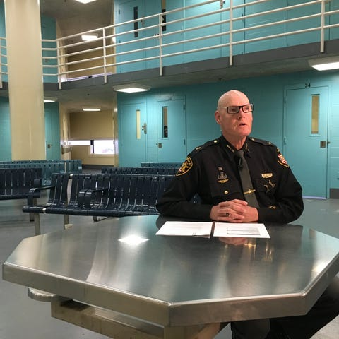 Hamilton County Sheriff Jim Neil sits in one of...