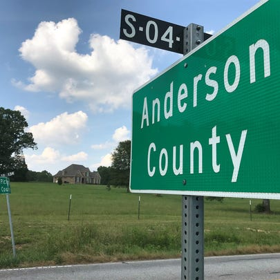 Pickens County assessors, armed with tape measures,