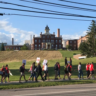 Marchers picket past the old Mary Fletcher Hospital
