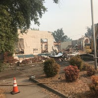 Why demolition crews of the old Redding police station are saving its big green doors