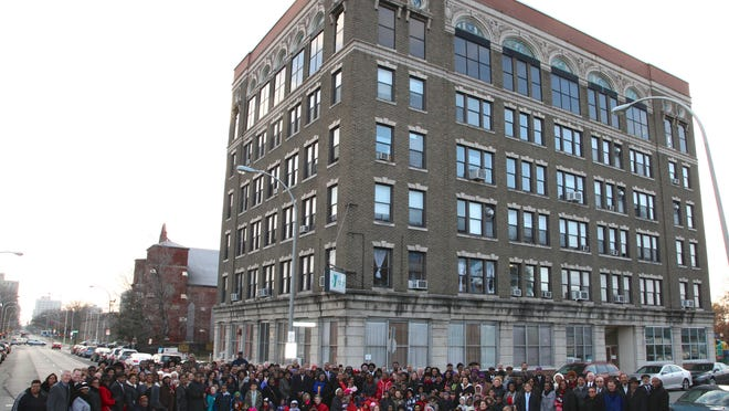 Over 200 people, volunteers, employees, former employees and others that simply have ties to the Chestnut St. YMCA, came out to participate in a reenactment celebrating the centennial of a historic photograph from when the building's first cornerstones were set. Nov. 26, 2014
