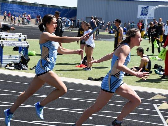 Reed senior Erika Robtoy takes the baton from Alysia