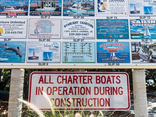An information board lists the charter businesses at the Naples City Dock on Tuesday, April 25, 2017. The Naples City Dock closes May 1 for a nine-month rebuild, forcing fishing, sailing and sightseeing captains to relocate.