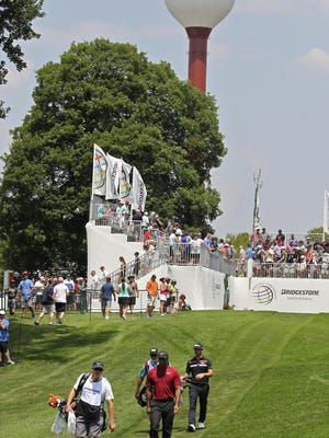 "The world-famous Firestone Country Club water tower should be among the local landmarks included in the ""Akron on Deck"" playing card set being developed by Akron artist Mac Love and 52 other local artists. Here, Tiger Woods and Wade Ornsby head down the No. 10 fairway during the final round of the WGC-Bridgestone Invitational in 2018."