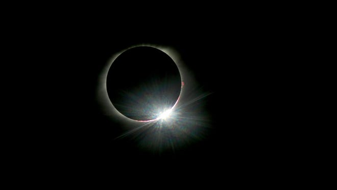 The diamond ring appears as the moon starts to move away from totality during the total eclipse, on Monday, Aug. 21, 2017 in Murfreesboro, Tenn.