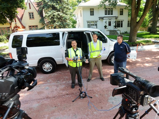 Wes Philips, principal engineer for streets with Sioux Falls Public Works, shows off a van Tuesday used by Infrastructure Management Services to survey street pavement in the city.