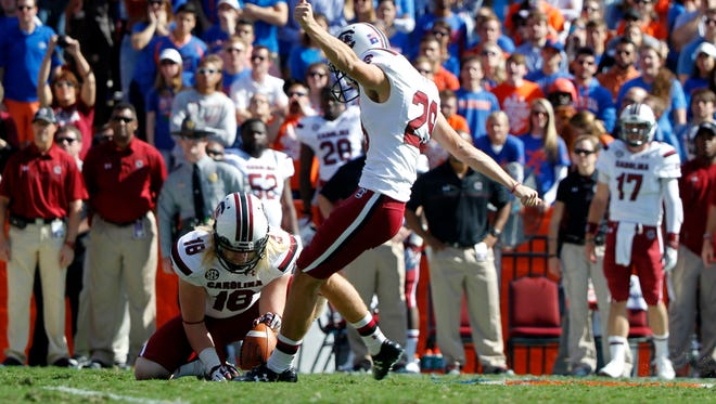 South Carolina Gamecocks place kicker Elliott Fry (29) kicks a field goal against the Florida Gators during the first quarter at Ben Hill Griffin Stadium.