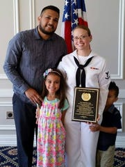 Petty Officer 3rd Class Kaleesha Ramos, right, recently