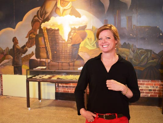 Beth Spivey at mural for use with al's column.jpg