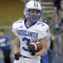 Highlands' Jared Pulsfort reacts after scoring a   touchdown during the Bluebirds' football game against Covington Catholic Saturday.