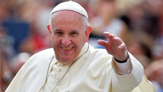 Pope Francis waves to faithful upon his arrival on St. Peter's square at the Vatican to lead his weekly general audience on September 16, 2015. AFP PHOTO / VINCENZO PINTOVINCENZO PINTO/AFP/Getty Images ORG XMIT: 857 ORIG FILE ID: 544298955