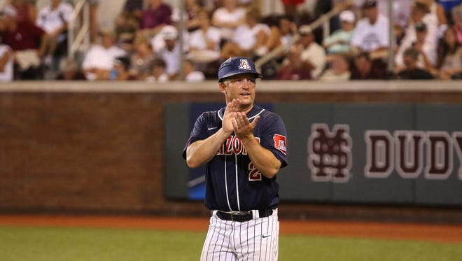 Arizona head coach Jay Johnson encourages his team during the 10th inning of their NCAA super regional baseball championship tournament game against Mississippi State in Starkville, Miss., Saturday, June 11, 2016. Arizona won 6-5 in 11 innings.