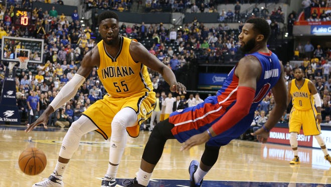 With less than a minute to go in the game in a controversial call Indiana Pacers center Roy Hibbert (55) is called for an offensive foul against Detroit Pistons center Andre Drummond (0) at Bankers Life Fieldhouse on Friday. Detroit defeats Indiana 98-96.