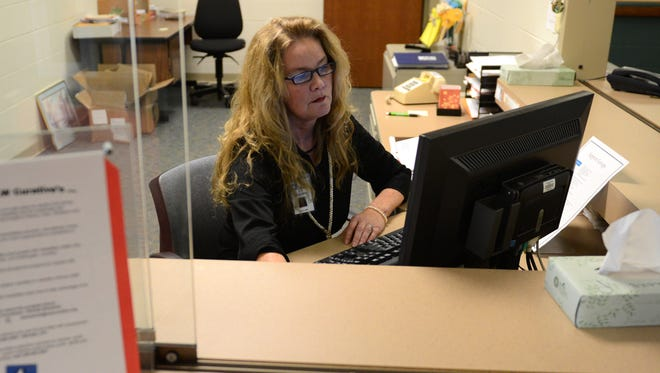 Suzanne Pellosmaa works at the reception desk as a participant in the Senior Service Program at N.E.W. Curative Rehabilitation, Inc..