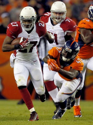 Joe Mahoney/AP Cardinals running back Chris Johnson, left, escapes a tackle Thursday. Arizona Cardinals running back Chris Johnson (27) escapes the reach of Denver Broncos linebacker Zaire Anderson (47) during the first half of an NFL preseason football game, Thursday, Sept. 3, 2015, in Denver. (AP Photo/Joe Mahoney)
