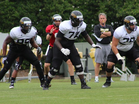 Southern Miss' Ty Pollard works at right tackle during