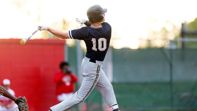 Providence's Timmy Borden swings during the high school baseball game between the Jeffersonville Red Devils and the Providence Pioneers at Jeffersonville High School.