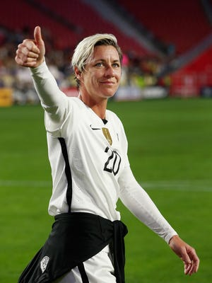 Abby Wambach waves to fans as she walks off the field Dec. 13, 2015 against China.