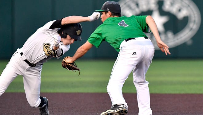 Clyde's Payton Laughlin tries dancing away from Bangs' Colton Brewer, but still was tagged out during Thursday's Region 1 Class 3A bi-district playoff baseball game at Abilene Christian University May 3, 2018. Final score was 13-3, Clyde.