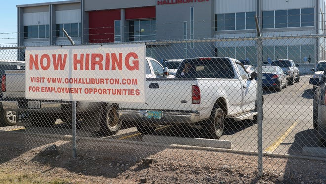 In this Friday, Dec. 16, 2016 photo, prospects for employment in the oil field are beginning to have positive signs as indicated by this hiring sign in front of the Halliburton facility in Odessa, Texas.