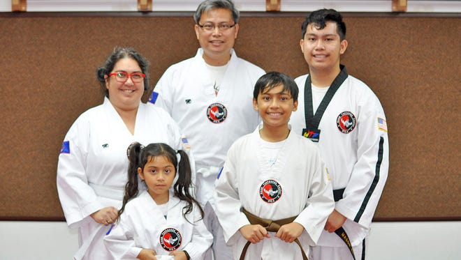 Bottom row, left to right, Malia, 7, and Micah Edusma, 12. Top row, left to right, Kimberly, 44, Rogel, 45, and Mason Edusma, 18 at the Guam Taekwondo Center, Dededo. The family of five bond and stay fit together through taekwondo.