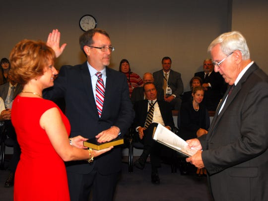 Current Brevard County State Attorney Phil Archer was sworn in by Norm Wolfinger in January, 2013.