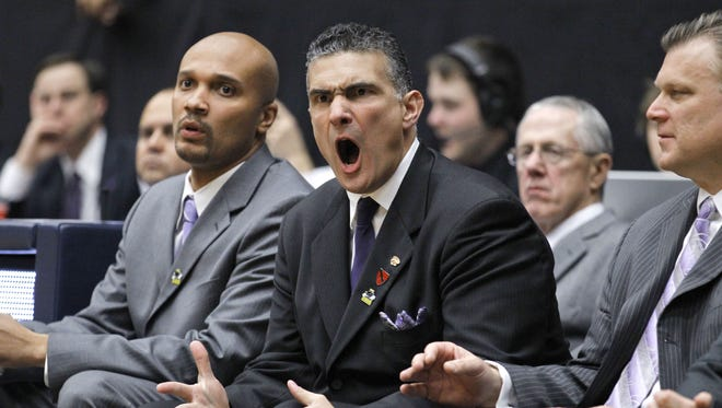 Kansas State coach Frank Martin, center, is joined by assistant coaches Dalonte Hill, left, and Brad Underwood as he watches his team play against Utah State during a Southeast Regional NCAA college basketball tournament second-round game Thursday, March 17, 2011, in Tucson, Ariz. (AP Photo/Chris Carlson)